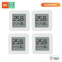 4 Stueck Xiaomi BT Thermometer 2 Drahtloser intelligenter elektrischer digitaler Hygrometer-Feuchtigkeitssensor Arbeiten Sie mit Mijia APP