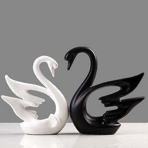Dekofiguren aus Porzellan Schwäne 2-er Set dynamisches Design schwarz/weiß