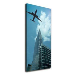 Tulup® Leinwandbild - 50x125cm - Wandkunst - Drucke auf Leinwand - Leinwanddruck - Wohnzimmer Wanddekoration XXL - Wohnung Deko Kunstdrucke - Fahrzeuge - Blau - Flugzeug über der Stadt