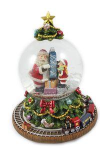 Schneekugel mit Spieluhr als Weihnachtsbaum, rotierender Sockel mit Zug H.: 18cm
