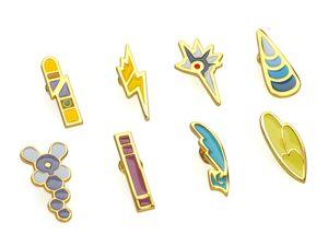 Pokemon Pin Set mit Arena Orden | 8 Anstecker mit Sammelbox | Einall Liga