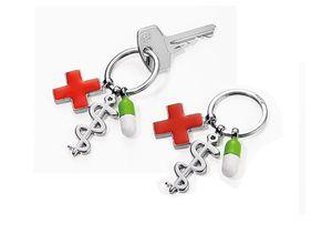 Schlüsselanhänger Rotes Kreuz bunte Pille und Äskulapstab GET WELL Troika
