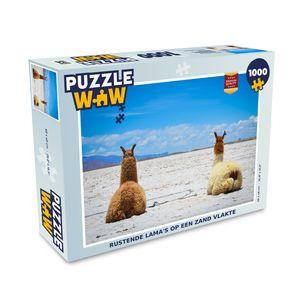Puzzle 1000 Teile - Lamas ruhen sich auf einer sandigen Ebene aus