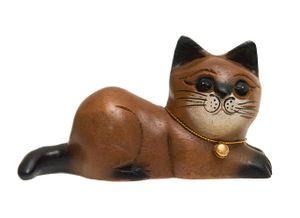 Katze, liegend, zur Seite schauend, Holz, Holzfigur
