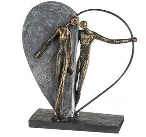 Casablanca Skulptur Herzklopfen Poly/Metall, Pärchen bronzefarben vor grauem Herz 16262