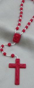 Rosenkranz aus Kunststoff mit roten Perlen, einem Medaillon und einem Kreuz, 42 cm