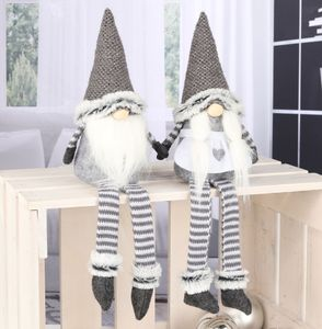 Weihnachtswichtel sitzend mit langen Beinen - 2er Set (Mann und Frau)