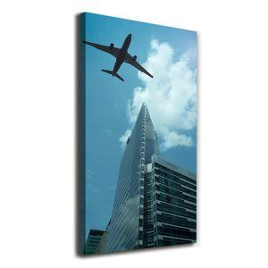 Tulup® Leinwandbild - 50x100cm - Wandkunst - Drucke auf Leinwand - Leinwanddruck - Wohnzimmer Wanddekoration XXL - Wohnung Deko Kunstdrucke - Fahrzeuge - Blau - Flugzeug über der Stadt