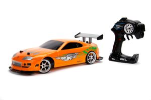 Jada Toys Fast & Furious RC-Auto, Drift 1995 Toyota Supra, Turbo, Driftfunktion, Allradantrieb, Ferngesteuertes Auto, 2-Kanal Funkfernbedienung, USB Ladefunktion, 4 Ersatzreifen, 1:10, orange